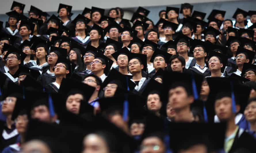 Students attend their college graduation ceremony in Shanghai's Fudan University. China's education minister has said there is no place for western values in university teaching.