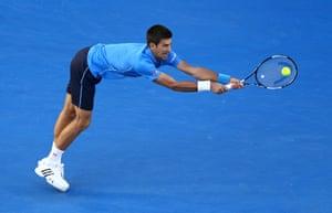 Djokovic reaches his backhand.