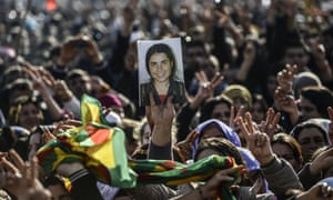 Kurdish people hold a picture of dead fighter during a celebration rally near the Turkish-Syrian border at Suruç on Tuesday