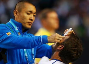 Stan Wawrinka receives eye drops from medical staff .