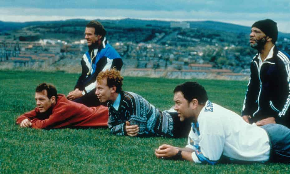 A scene from The Full Monty with Sheffield in the background.