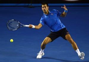 Djokovic hits a return.