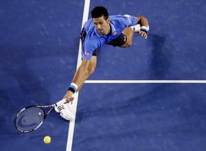 Novak Djokovic stretches out for a return.