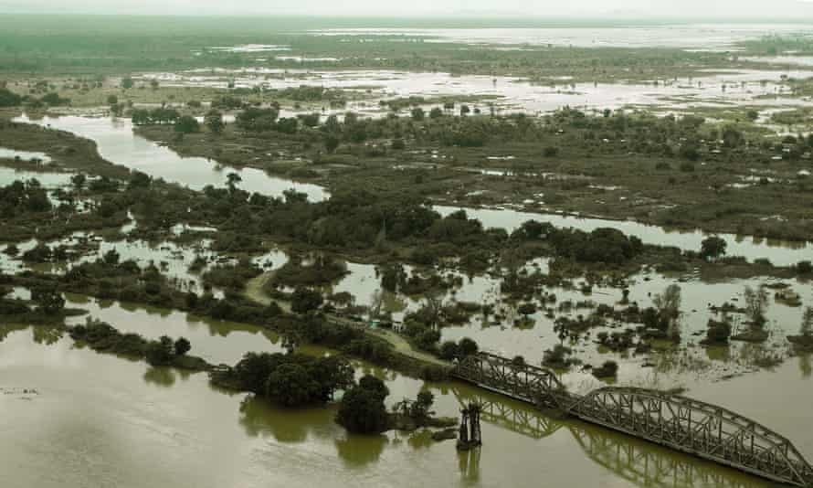 An aerial view taken on January 20, 2015 shows a flooded area is seen at Makhanga in Malawi's most southern district of Nsanje.  A total of 176 people have been confirmed dead in the floods, with 153 missing and 200,000 homeless, according to official figures.
