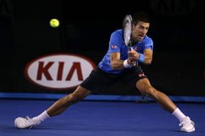 Djokovic plays a backhand.