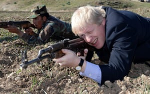 London Mayor Boris Johnson takes aim with an AK47