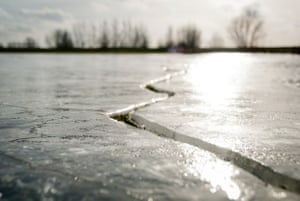 a crack in an ice covered lake