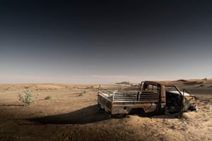 a broken down truck in the middle of the desert