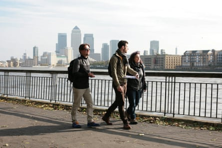 Walking along the Thames in London.