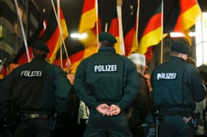 German police officers guard a Pegida march in Düsseldorf.