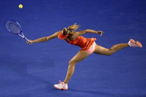 Maria Sharapova stretches for a forehand but is struggling to make any impact on her opponent's serve.