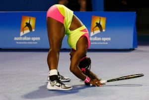 Serena Williams reacts after hitting a return to Maria Sharapova who is battling hard to stay in the match.
