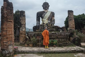 Chan Duong Ly, 85, a monk at the Wat Phia Wat monastery in Muang Khoun, the former capital of Xieng Khouang province. The city was extensively bombed during the war and almost totally abandoned in 1975. The monastery, which dates back to the 1322, was bombed by the US in 1966 because suspected of having been converted in a food storage used by the North Vietnamese. The blackened and scarred Buddha statue in the monastery courtyard is among the few remains of the pre-war period.