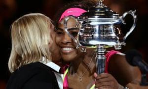 Serena Williams receives the trophy from Martina Navratilova.
