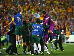 The Australian bench go wild after James Troisi scores in extra time.