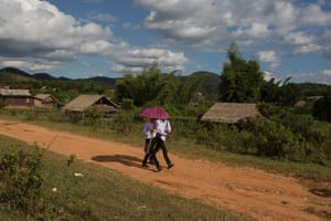 Schoolchildren from the village of Nong Tang, Xieng Khouang province, walking along what used to be Lima Site L-108, an airstrip used by the CIA during the Secret War. The village was then known as Muang Sui.