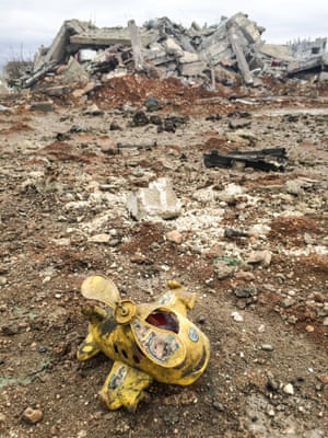 A child's toy lies amid the ruins
