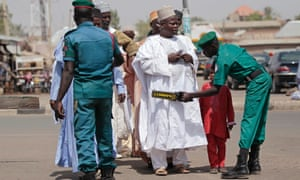 Members of a volunteer security group screen Muslims heading for Friday prayers in Gombe, Nigeria, after an attack outside a mosque by Boko Haram militants.