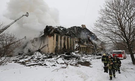 Firefighters extinguish a blaze in the library in Moscow, Russia