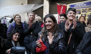 Finance Ministry's laid-off cleaning women react as they watch on television the new Greek Finance Minister Yanis Varoufakis announcing that the government will re-hire them, in Athens, on 28 Jan 2015.