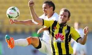 Jade North battles with Jeremy Brockie in Sunday night's A-League clash between Wellington Phoenix and Brisbane Roar.