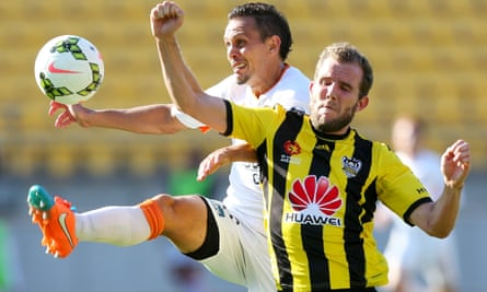 Jade North battles with Jeremy Brockie in Sunday night's A-League clash between Wellington Phoenix and Brisbane Roar.