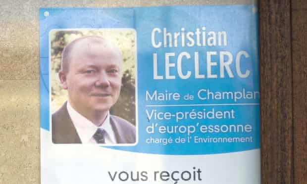 A poster in Champlan bears the picture of mayor Christian Leclerc