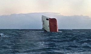 Upturned hull of the Cemfjord in the sea 15 miles from Wick before it sank on Sunday