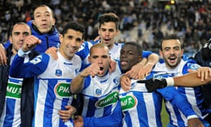 Grenoble's players celebrate with supporters after winning their French Cup match against Marseille