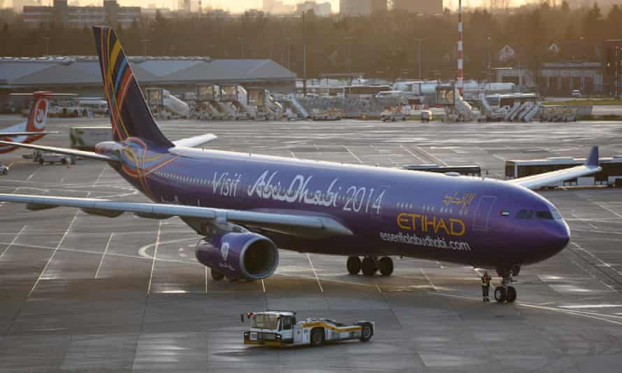 An airplane of UAE carrier Etihad taxis at Duesseldorf, Germany. The flight from Abu Dhabi was delayed along with others after fog disrupted schedules.