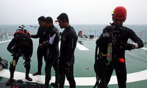 Divers on the deck of a search and rescue ship on Sunday.