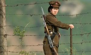A North Korean soldier at the international border between North Korea and China on the Yalu river.