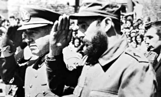 General Augusto Pinochet (L), then Chile's Army Chief, saluting alongside Cuban leader Fidel Castro