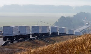 A Russian convoy of trucks carrying humanitarian aid for Ukraine travels along a road south of the city of Voronezh in August 2014.