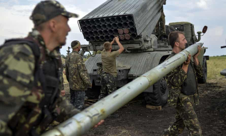 Ukrainian soldiers charge a Grad multiple rocket launcher system, near the eastern Ukrainian city of Shchastya, Luhansk region, in August 2014. Russian-backed rebels use similar weaponry.