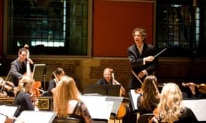 Conductor Nicholas Collon with the Aurora Orchestra