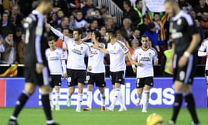 Valencia's Antonio Barragan, second left, celebrates after scoring against Real Madrid and helping to stop the club's 22-game winning streak.