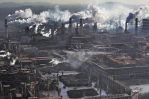 Thick yellow smoke produced by oxygen cutting at the Wen'an steel plant in Wu'an gives off a pungent stench.