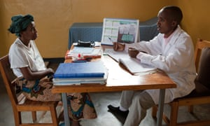 A doctor explains treatment procedure to a patient in Butare, Rwanda.