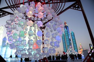 Visitors tour the ice and snow sculptures
