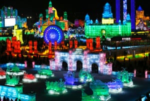 Ice sculptures are illuminated by coloured lights during the opening day