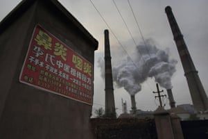 There are many signs, like this one, posted in the residential areas around Handan Iron and Steel Group's plant, advertising cures for rhinitis, pharyngitis and other respiratory conditions.
