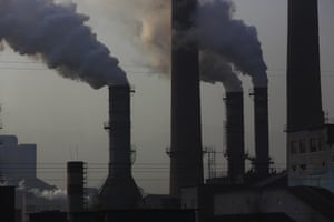 Smoke rolls out of the chimney stacks of the steel furnaces belonging to Qian'an Zhayi Iron & Steel Group Company in Hebei province. As night falls, the pollution grows more serious.