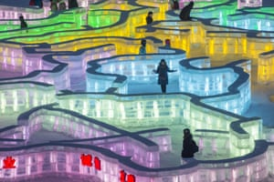 Visitors walk in an ice maze
