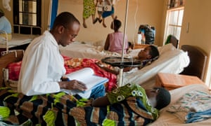 Dr Eric Bagamizi visits a patient at Rwinkwavu Hospital in south-east Rwanda. Rwandans pay only $2 a year for health insurance.
