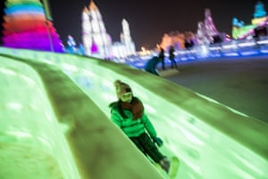 A girl tries out an ice slide