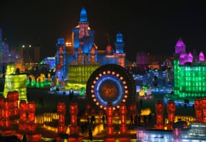 Huge ice sculptures illuminated by coloured lights