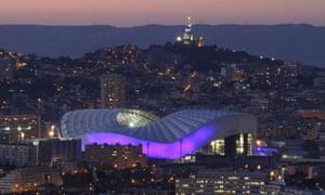 The Stade Vélodrome in Marseille, with Notre Dame de la Garde basilica in the background.