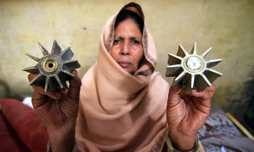 A villager shows mortar shells at the India-Pakistan border in the Samba district of Jammu.