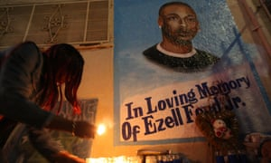 Tritobia Ford lights candles at a memorial for her son, Ezell Ford, at the site where he was shot and killed by two LAPD officers in August.